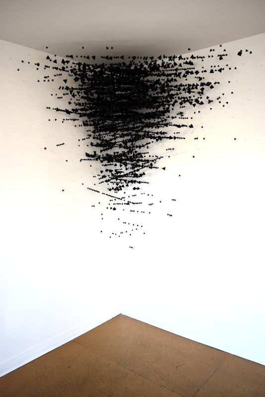 Pod, 3,500 folded paper triangles, fishing line and hooks, 2016,